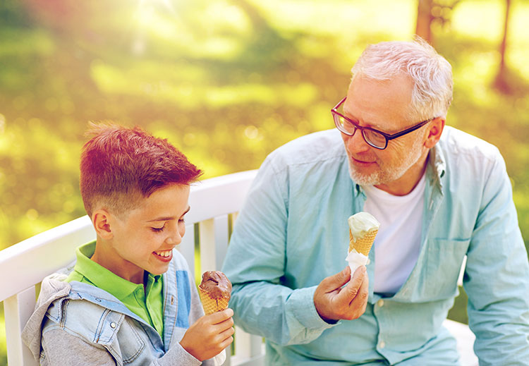 old-man-and-boy-eating-ice-cream-at-summer-park